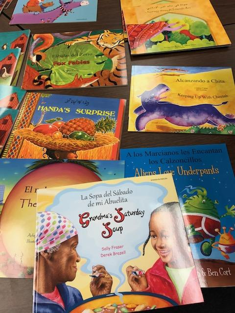 The ESOL room has many bilingual books in different languages that are available for students and teachers to borrow.  Just ask your ESOL teacher!